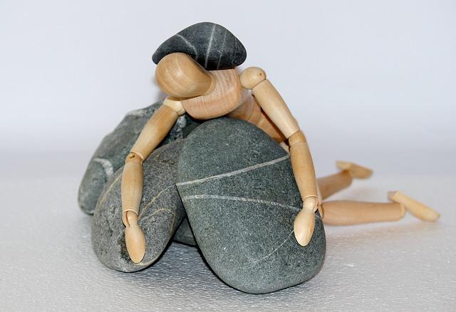 重しに潰れる人のイメージ