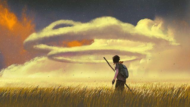 幻想的なわっかになった雲と旅する青年