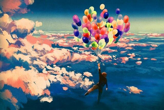 幻想的な風船につかまって空飛ぶ男の子